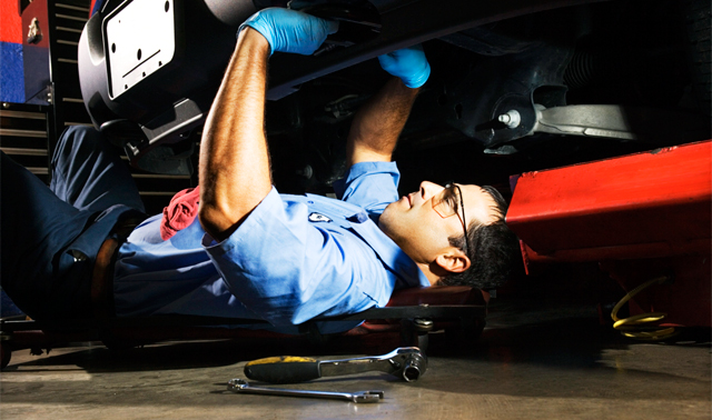 man working on bumper